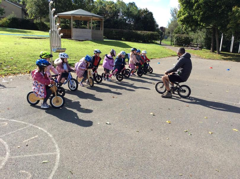 Mr Burns helped us to learn to balance and ride our bikes.