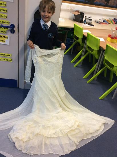 Samuel with a wedding dress worn during WWI!