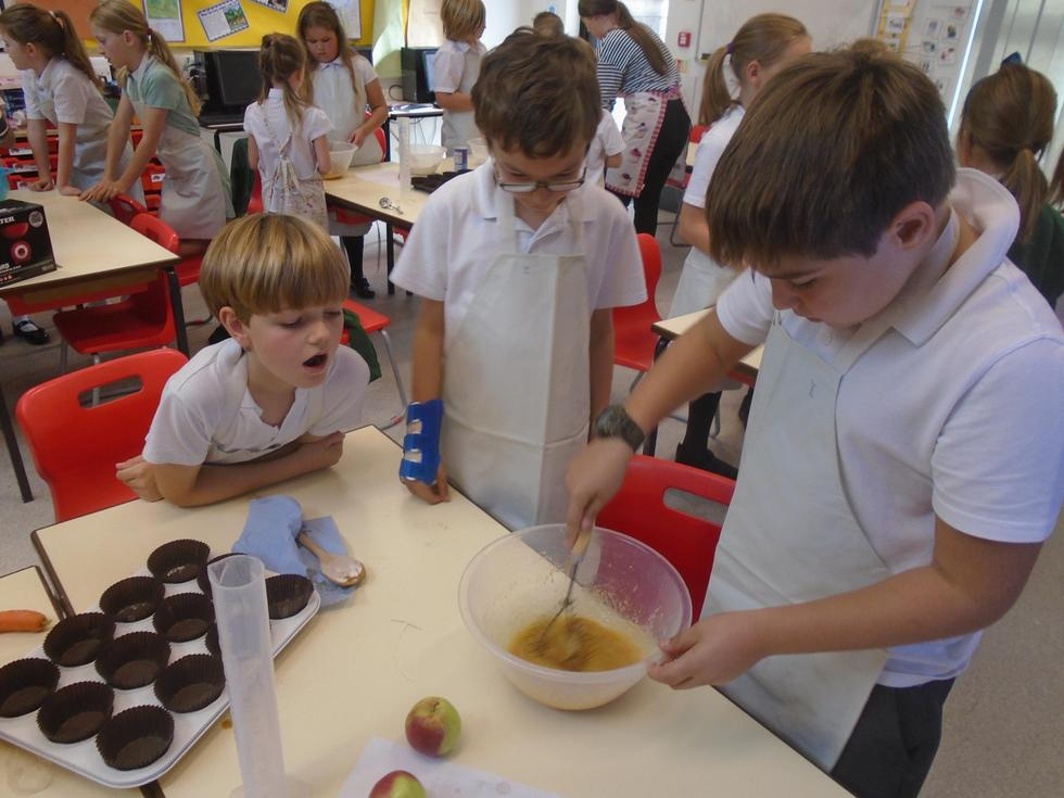 Mixing the apple and carrot muffins!