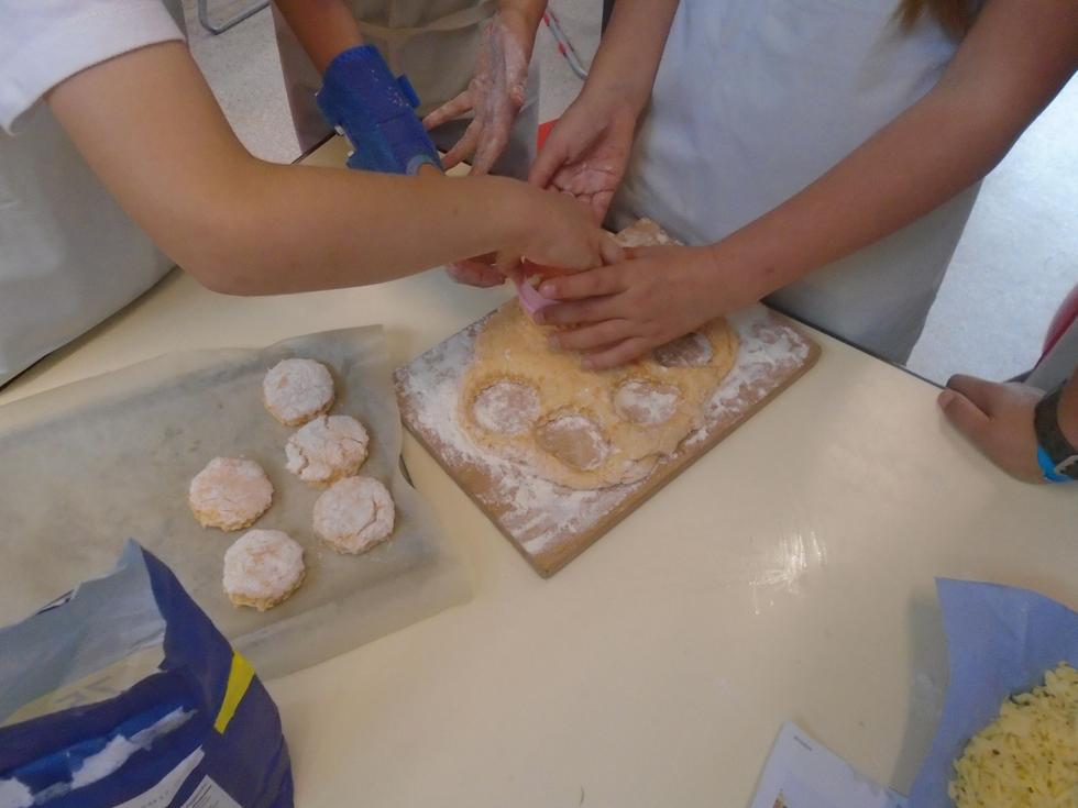 Cutting out the scones.