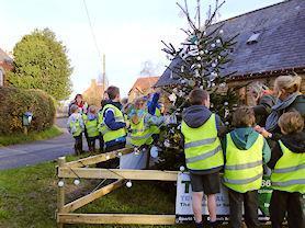 Decorating the village Christmas tree