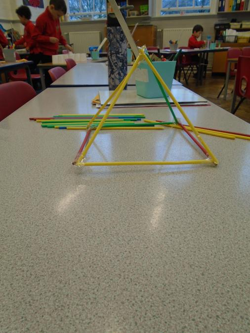Zeenah made a pyramid using art straws and cello-tape.