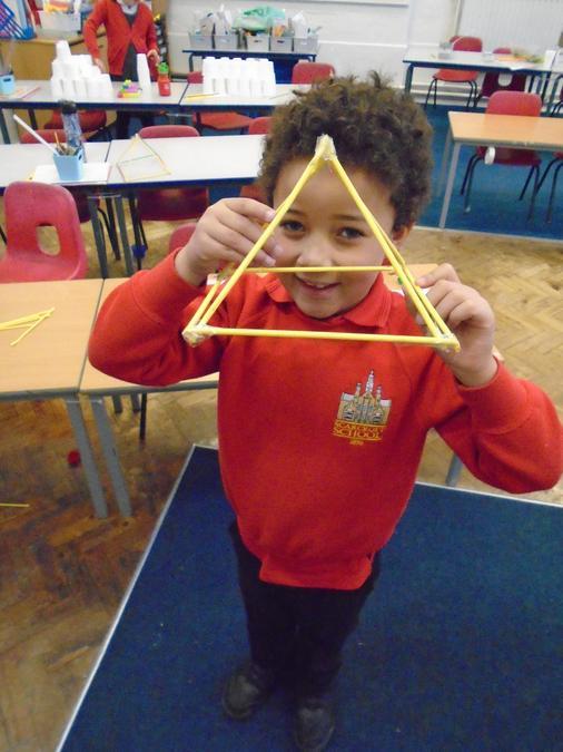 A true pyramid made from art straws.