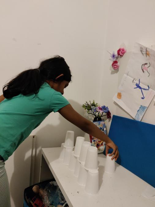 Akshara has created a pyramid using cups!