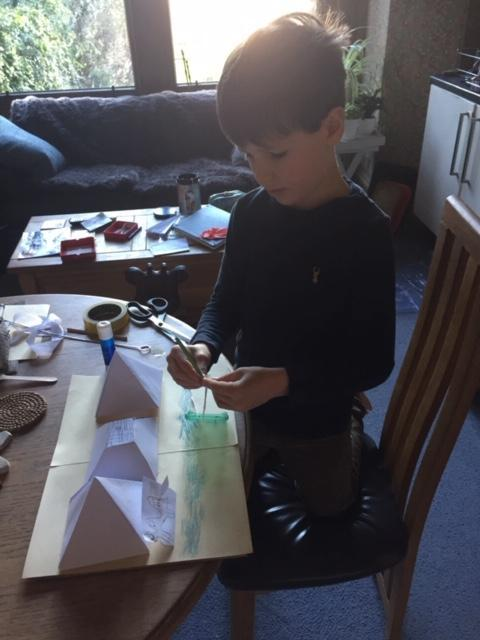 Jack is busy making his pyramid model.