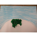 Using small pieces of tissue paper, collage the grass on the mound.