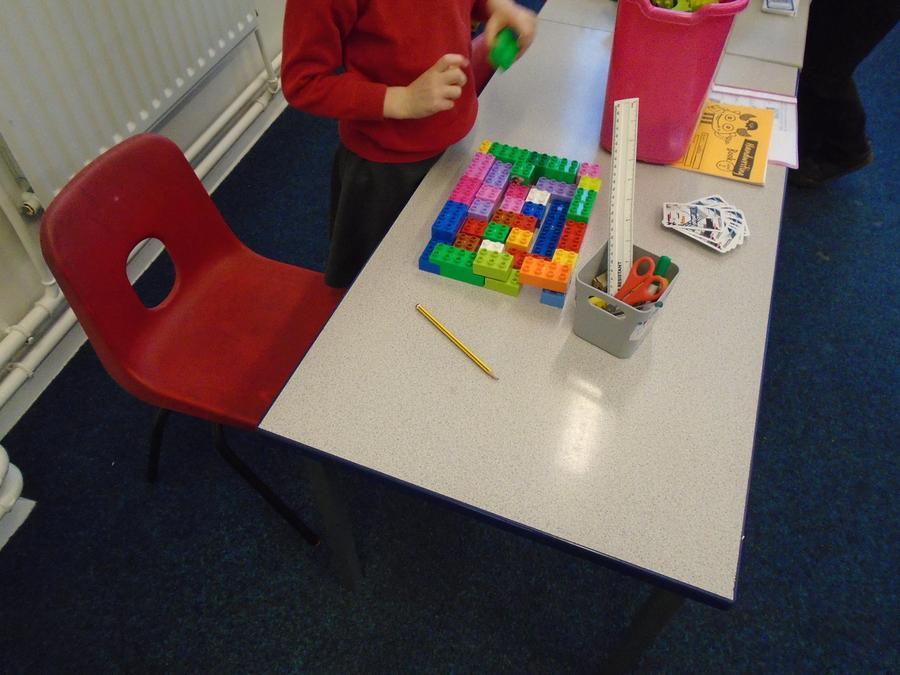 Sofia building her Dulpo pyramid.