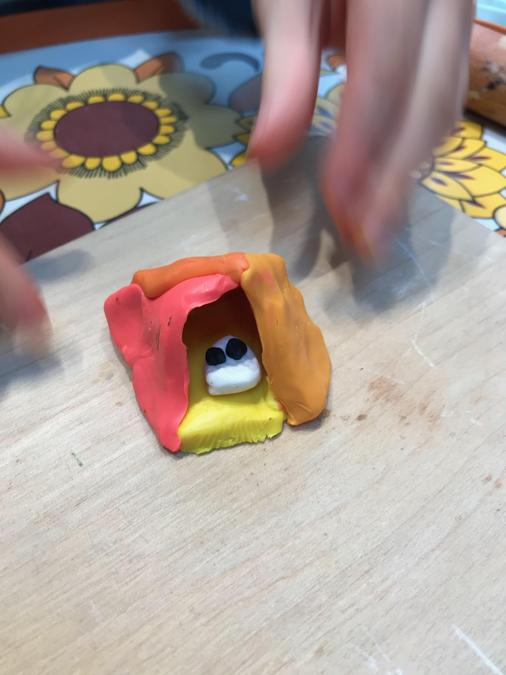 Iris has used modelling clay to create her fabulous pyramid, it even has a mummy inside!