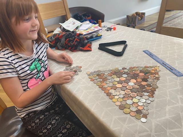 Using coins to make a big pyramid!