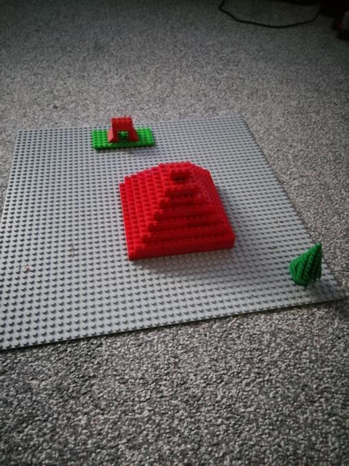 Kayden made a a step pyramid using red Lego bricks.