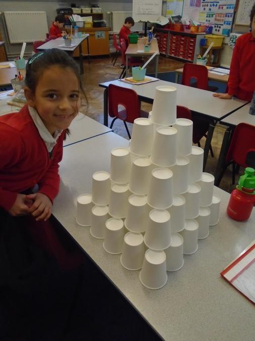 Step pyramid made from cups.
