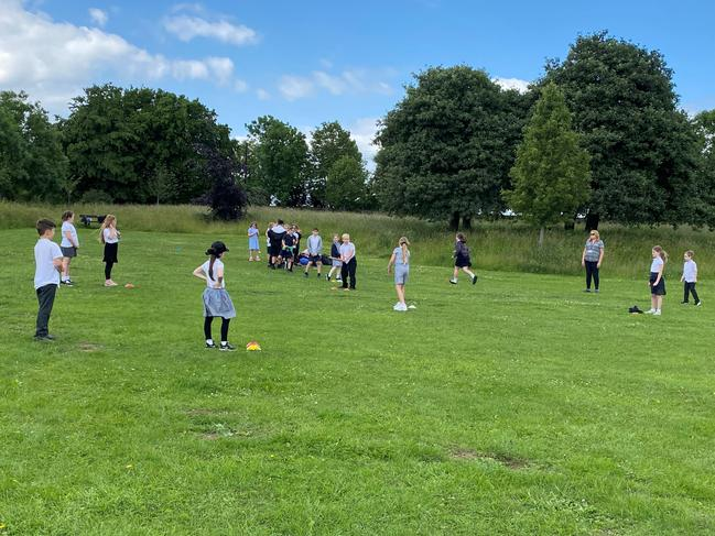 Enjoying a game of Rounders