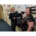 Olivia in Yr 6 receives her hoodie from Mrs Beck.