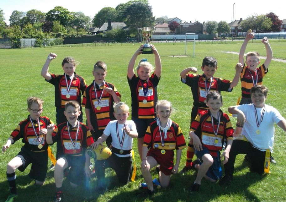 Lifting the cluster rugby cup at Monwearmouth.