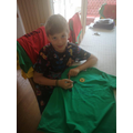 Alexander with £3 House Team t-shirt on sale.