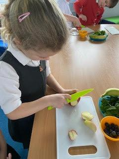 Learning the skills necessary to chop fruit safely.