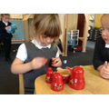 Great determination sorting the Russian Dolls.