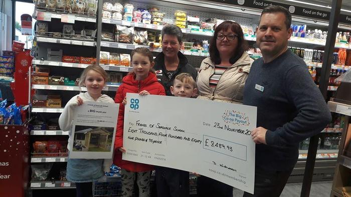 Receiving our cheque from Seascale store manager David, an impressive £8,489.93 was raised