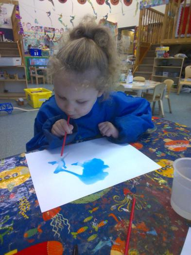 We used watery paint and straws to create funny alien shapes