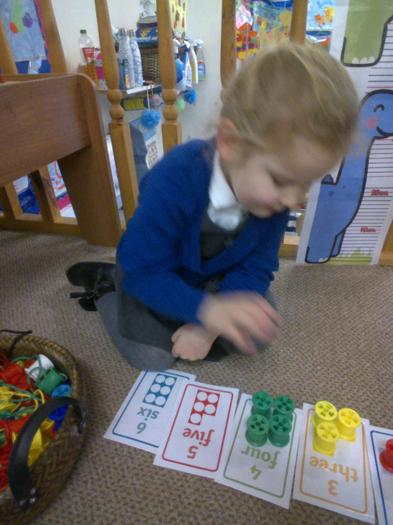 Evie matched the bobbin colours to the Numicon cards