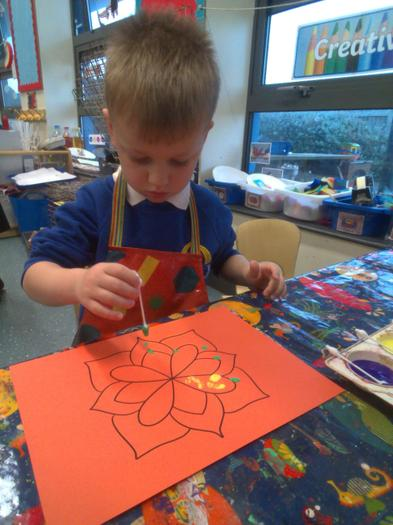 Making Rangoli patterns using our fine motor skills