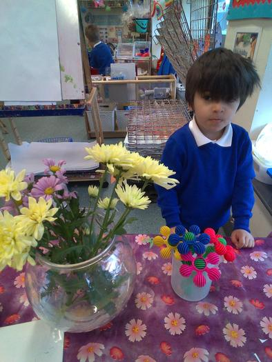 "Haris named the different parts of a flower, ""stem, leaves, petals."""