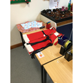 Taking on the role of Santa's helpers in our role play area provided lots of opportunities to measure, weigh, cut, label, tally and post.