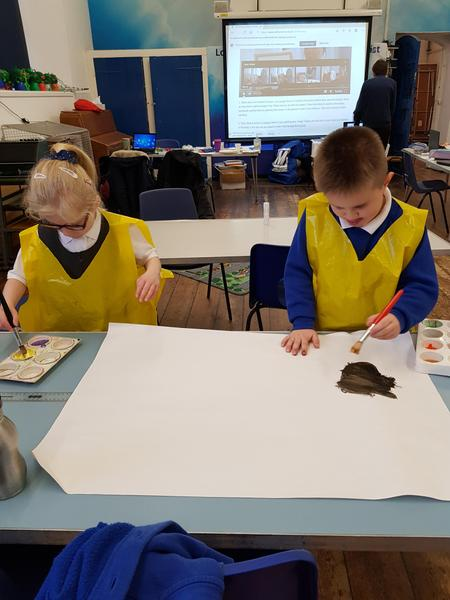 Aivah and Ernie painting for choosing