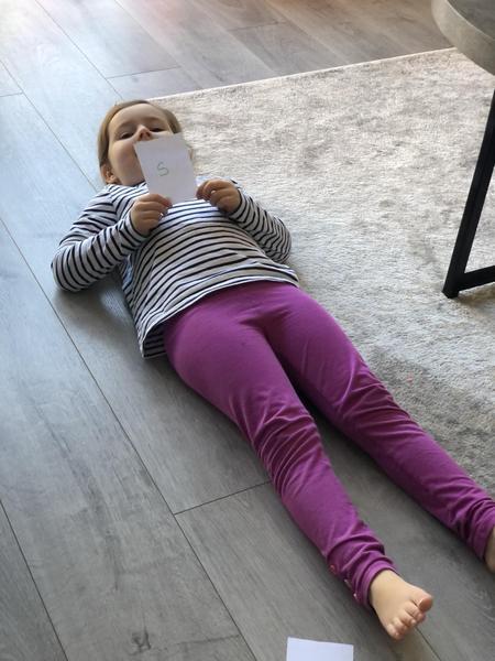 Millie phonics - 's' for sunbathing