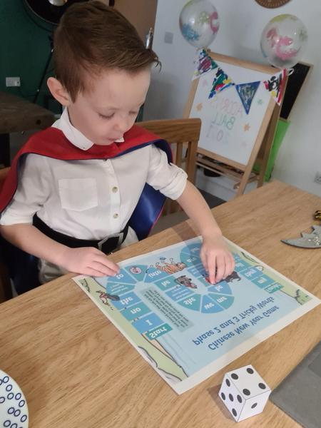 Prince Harvey playing tricky words game