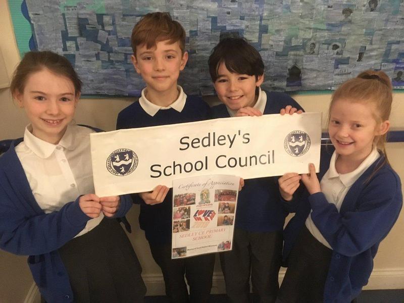 School Council receiving their Love in A Box certificate