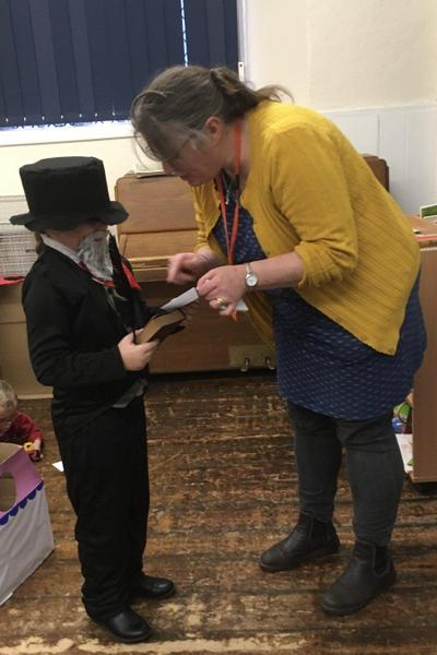 Mrs Pettis (PFA) presenting Poppy (Y3) with her World Book Day Winning prize