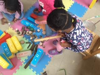 Reva building the three little pigs house