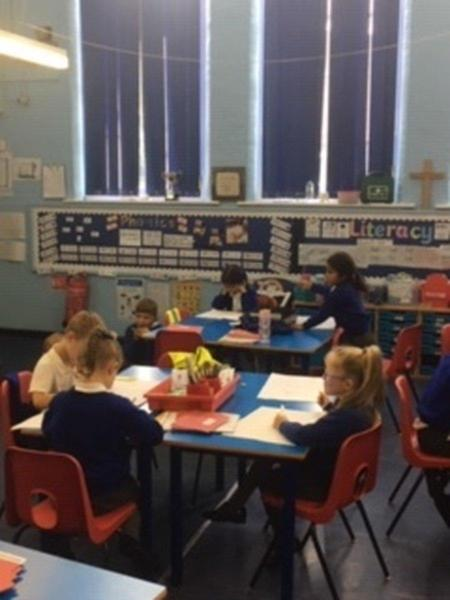 Practicing their handwriting in Seedlings class Y1/Y2
