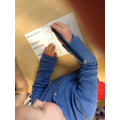 Reading and marking a ballot paper.