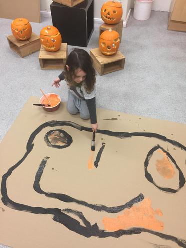 Drawing and redrawing pumpkins.
