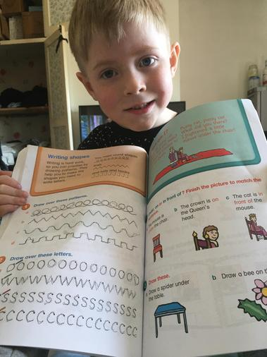Warren is working hard on his letter formation.