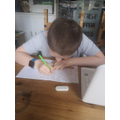 Connor hard at work on some maths!