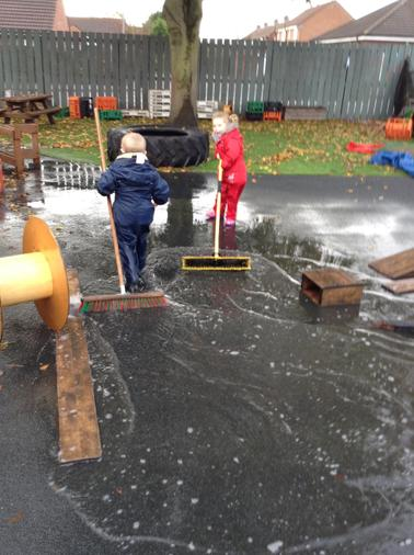 Testing our muscles out, sweeping away the puddle.