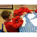 Getting  messy with shaving foam!