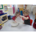 Evie carefully poured the milk into the mixture