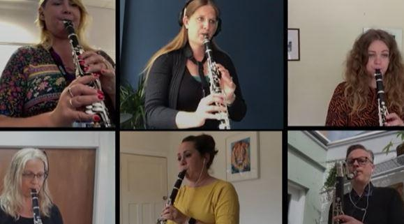 A photograph of the woodwind teachers playing different types of clarinet.