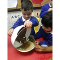 Pouring in the melted chocolate.
