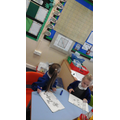 Using our maths wall to check answers