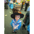 Poppy tried Miss Swan's Mad Hatters Hat on!