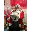 Evie-Beth meeting Santa.