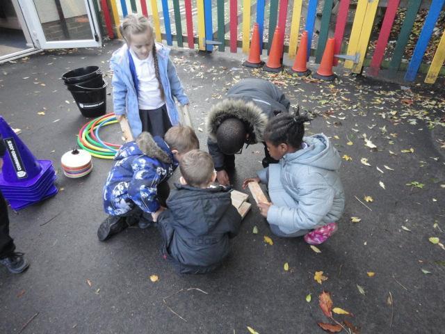 Reception children planning a shelter for CJ.