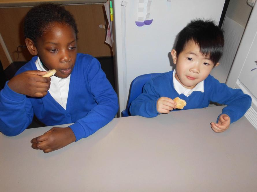 Adedolapo and Aaron eating a love heart biscuit