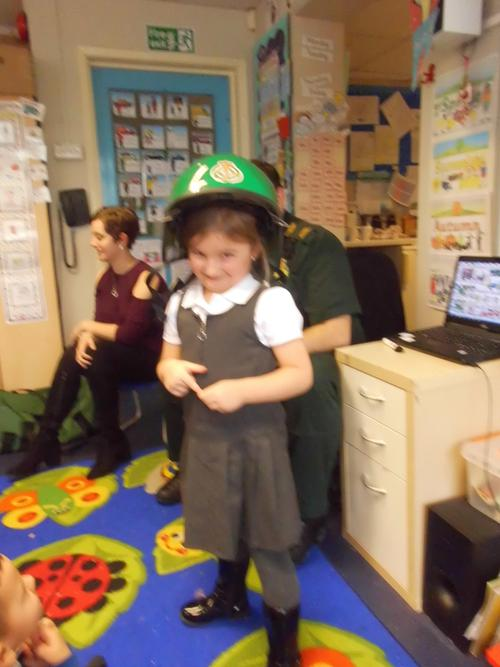 rosie trying on the green helmet