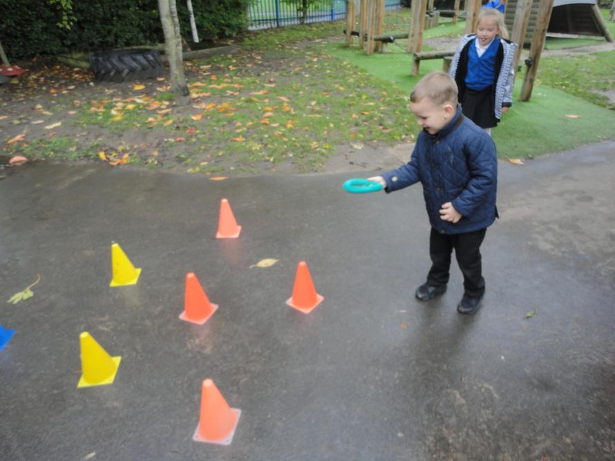 Trying to get the quoit onto the cone.
